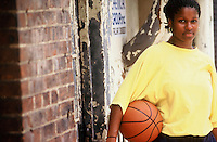 African-American female with basketball