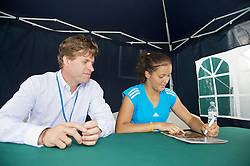NOTTINGHAM, ENGLAND - Saturday, June 13, 2009: Laura Robson (GBR) signs autographs on day three of the Tradition Nottingham Masters tennis event at the Nottingham Tennis Centre. (Pic by David Rawcliffe/Propaganda)