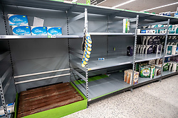 © Licensed to London News Pictures. 05/03/2020. London, UK. Empty shelves on the toilet paper aisle. Panic-buying continues to show in ASDA in South West London as shelves empty out of goods. Prime Minister Boris Johnson appeared on This Morning TV show to reassure the public that the Government is doing all it can to fight the coronavirus disease.. Photo credit: Alex Lentati/LNP