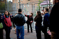 Cynthia Yee points out a building used as a brothel as her group stands near the basketball court that was filmed in the movie, Pursuit of Happyness, starring Wil Smith, on Hang Ah Alley, or Pagoda Alley, in San Francisco, Ca., on Friday, June 18, 2010.