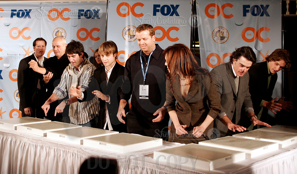 Oct 28, 2004; Newport Beach, CA, USA; Cast & Producers of the FOX hit TV show 'The OC' visited the Balboa Penninsula in Newport Beach to get a Key to the City and be immortalized in cement with thier hand prints to be placed at the enterance to the Historic Balboa Pavillion. (L-R) ALAN DALE, MELINDA CLARKE, PETER GALLAGHER, JOSH SCHWARTZ, MCG, BENJAMIN MCKENZIE, MICHAEL CASSIDY.  Mandatory Credit: Photo by Shelly Castellano/ZUMA Press.