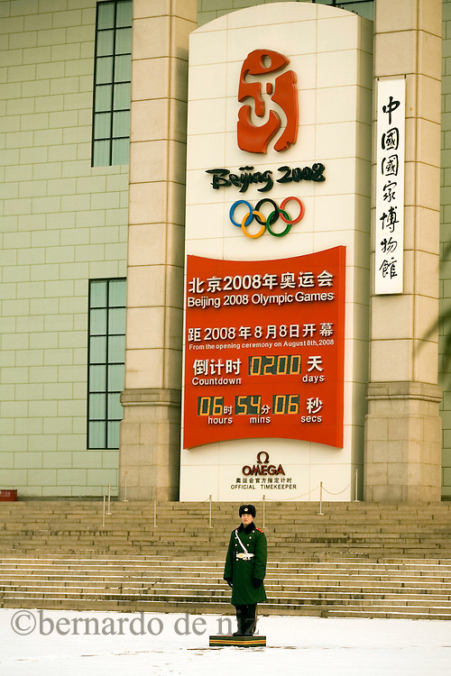 A paramilitary policeman stands guard near the Olympic countdown clock which shows 200 days until the opening of the Beijing Olympic Games, beside Beijing's Tiananmen Square Monday Jan. 21, 2008. Photos: Bernardo De Niz