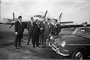 25/06/1965<br /> 06/25/1965<br /> 25 June 1965<br /> Arrival of Dr Carl H. Hahn of Volkswagen at Dublin Airport.<br /> Dr. Hahn, Sales and Service Director, Volkswagenwerke, A.G., Germany, arrived in Ireland on the company plane. He was President of Volkswagen of America. He had recently returned to Wolfsburg and was visiting Ireland as part of a brief European tour to familiarise himself with local conditions. Image shows Dr Hahnin front of his Beechcraft Kingair being greeted by Mr. Stephen O'Flaherty (shaking hands dark suit); Mr. Michael P. O'Flaherty (on right), Chairman Volkswagen Distributers Ltd. and Mr. Dermod Ryan, General Manager Volkswagen Distributers Ltd. (on left?). Also present were Mr. E. Schneider and Mr. U. (?) P. Kiesewetter, Factory Delegates for North West Europe. Car appears to be a Volkswagen Type 3.