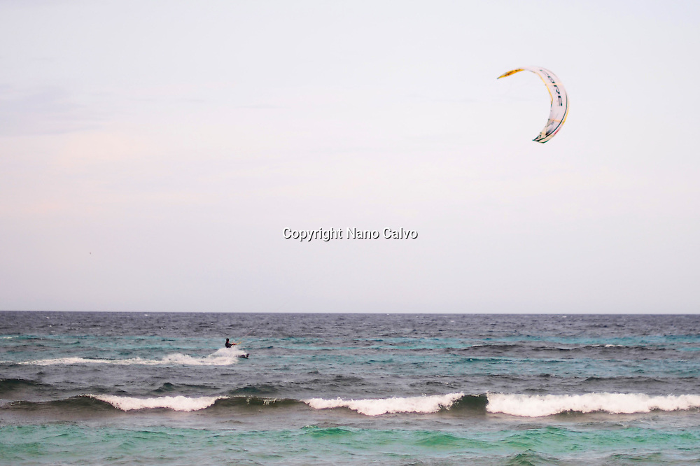 Kitesurfing in Es Cavallet beach, Ibiza, Spain