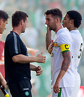 06/07/14 PRE-SEASON FRIENDLY<br /> RAPID VIENNA V CELTIC<br /> GERHARD HANAPPI STADIUM - AUSTRIA<br /> Celtic's Charlie Mulgrew (right) speaks with manager Ronny Deila after taking the captain's armband after Scott Brown is taken off injured.
