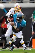 Jacksonville Jaguars quarterback David Garrard (9) scores a second-half touchdown in the Jags 20-17 overtime loss to the Washington Redskins at EverBank Field on Dec. 26, 2010 in Jacksonville, Fl. ©2010 Scott A. Miller