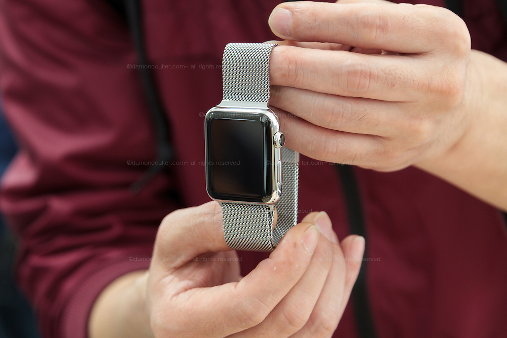 A customer plays with his newly bought Apple watches on its officail release at the Softbank Store in Omotesando, Tokyo, Japan. Friday April 24th 2015. Apple's long anticipated  smart watch was officially put on sale in stores in just nine countries. Japan and Australia which are furthest east were the first places in the world where this watch was available for purchase.