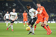 Derby County midfielder Florian Jozefzoon holds off Millwall defender Murray Wallace during the EFL Sky Bet Championship match between Derby County and Millwall at the Pride Park, Derby, England on 20 February 2019.