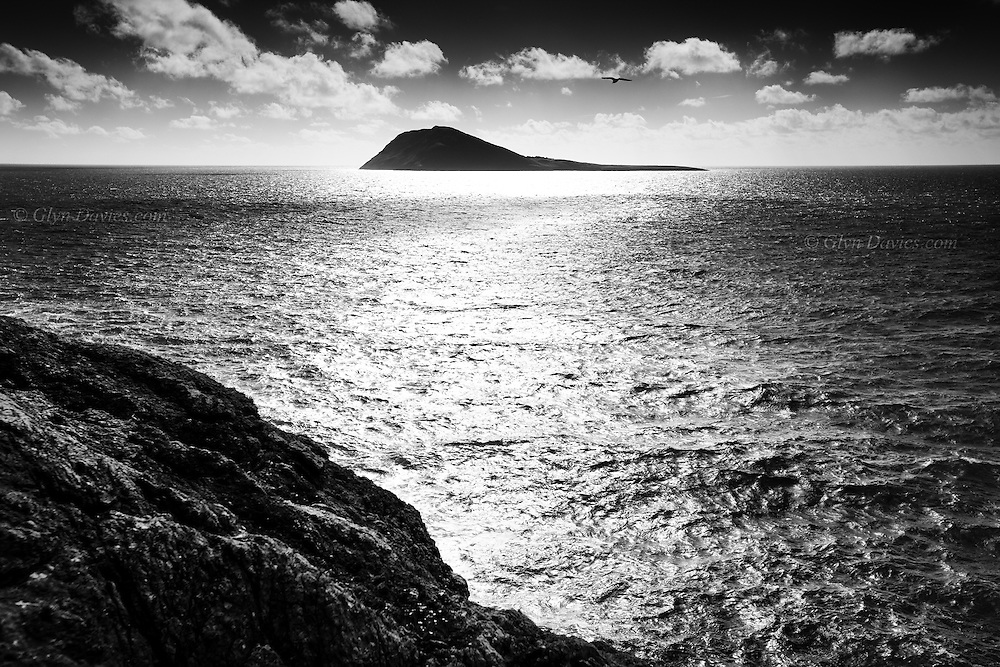 Intense sunshine and dramatic clouds and shadows over Bardsey Sound, the last stretch of treacherous water before the Pilgrims would have reached their destination, the remote but beautifully stark island of Ynys Enlli (Bardsey Island) at the most Westerly tip of the Llyn Peninsula, North Wales