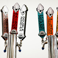 MIAMI, FLORIDA -- July 11, 2015 -- Beer taps in a tasting area at the new Biscayne Bay Brewing Company in Miami, Florida.  (PHOTO / CHIP LITHERLAND)