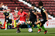 Swindon Town winger Keshi Anderson takes on Macclesfield Town defender Miles Welch-Hayes during the EFL Sky Bet League 2 match between Swindon Town and Macclesfield Town at the County Ground, Swindon, England on 14 September 2019.