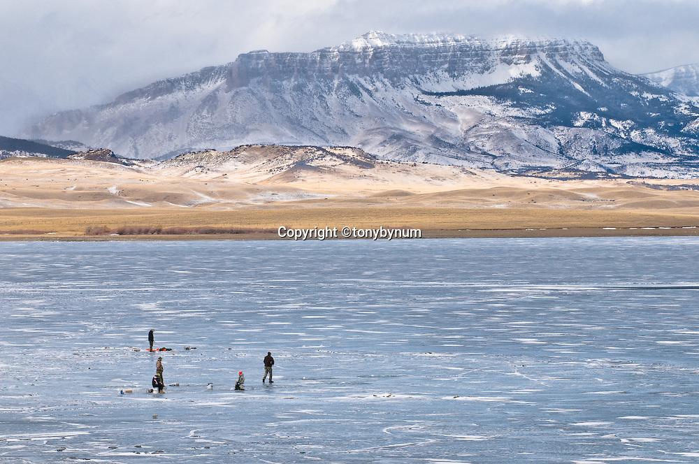 Fishing on frozen lake, ice fishing montana, USA