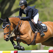 Adrienne Sternlicht riding Raia D' Helby in action during the $100,000 Empire State Grand Prix presented by the Kincade Group during the Old Salem Farm Spring Horse Show, North Salem, New York,  USA. 17th May 2015. Photo Tim Clayton