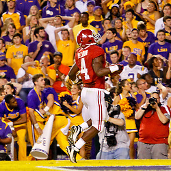 November 3, 2012; Baton Rouge, LA, USA; Alabama Crimson Tide running back T.J. Yeldon (4) runs after a catch for the game winning touchdown during the fourth quarter of a game against the LSU Tigers at Tiger Stadium. Alabama defeated LSU 21-17. Mandatory Credit: Derick E. Hingle-US PRESSWIRE