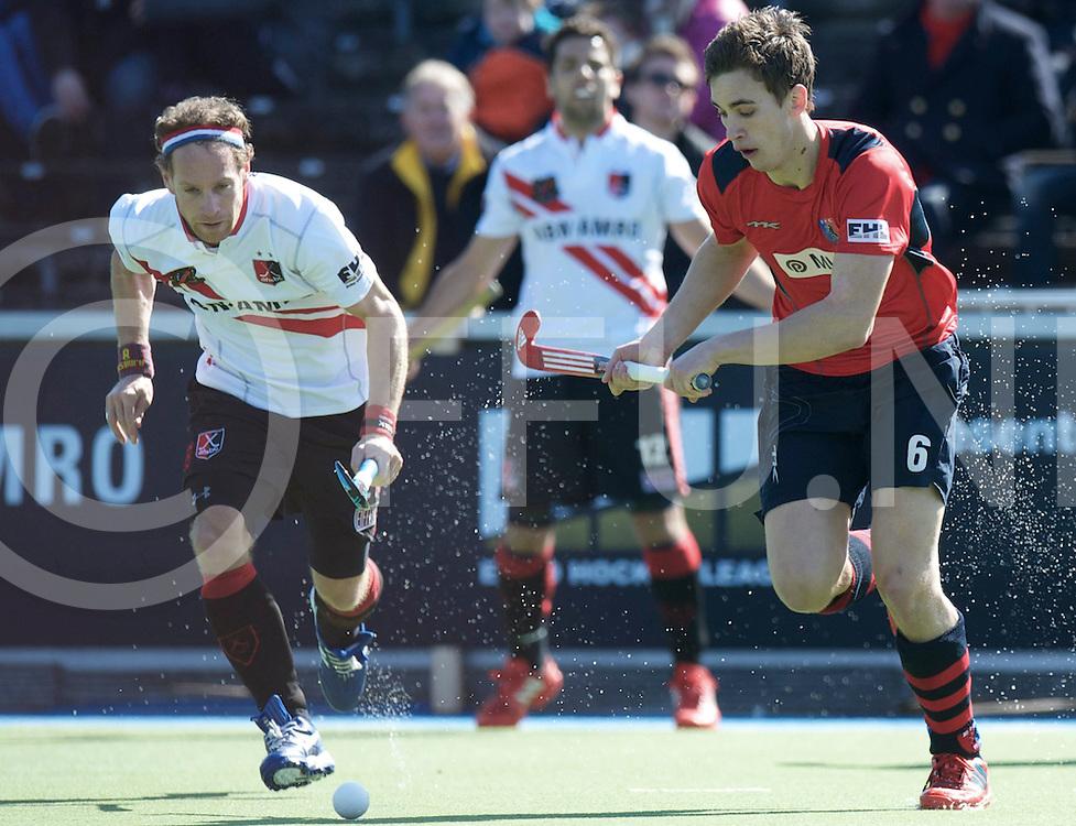 Amstelveen - Euro Hockey league KO16.Amsterdamse H&BC - Berliner HC.foto: Jonas Gomoll (red) and Teun Rohof (white)..FFU PRESS AGENCY COPYRIGHT FRANK UIJLENBROEK.