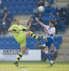 COLCHESTER, ENGLAND - Saturday, April 24, 2010: Tranmere Rovers' Marlon Broomes and Colchester United's Ian Henderson in action during the Football League One match at the Western Community Stadium. (Photo by Gareth Davies/Propaganda)
