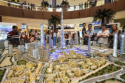 Large model of current and proposed property development with many apartment towers in Downtown Dubai by developer Emaar at Dubai Mall in United Arab Emirates