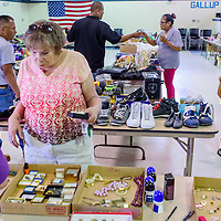 050115       Cable Hoover<br /> <br /> Customers browse for bargains in a selection of used goods during a rummage sale and the Gallup Community Service Center Friday. The sale was a fundraiser for the American Cancer Society's Relayu for Life and will continue Saturday from 8am until 1pm.