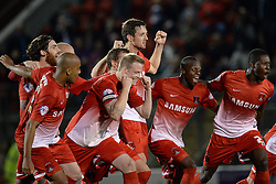 Leyton Orient players celebrate Leyton Orient's Lloyd James scoring the winning penalty - Photo mandatory by-line: Mitchell Gunn/JMP - Tel: Mobile: 07966 386802 08/10/2013 - SPORT - FOOTBALL - Brisbane Road - Leyton - Leyton Orient V Coventry City - Johnstone Paint Trophy