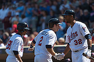 Brian Dozier #2 of the Minnesota Twins is congratulated by Aaron Hicks #32 after hitting a home run against the Seattle Mariners on June 2, 2013 at Target Field in Minneapolis, Minnesota.  The Twins defeated the Mariners 10 to 0.  Photo: Ben Krause