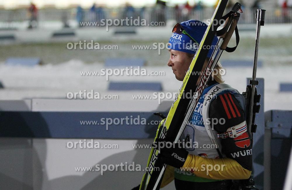 04.01.2012, DKB-Ski-ARENA, Oberhof, GER, E.ON IBU Weltcup Biathlon 2012, Staffel Frauen, im Bild Magdalena Neuner (GER) verlässt enttäuscht den Zielbereich // during relay Ladies of E.ON IBU World Cup Biathlon, Thüringen, Germany on 2012/01/04. EXPA Pictures © 2012, PhotoCredit: EXPA/ nph/ Hessland..***** ATTENTION - OUT OF GER, CRO *****