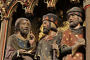 The Road to Emmaus, pilgrims returning from Jerusalem after Easter, realising that Jesus is the true prophet when the encounter the resurrected Christ, on the South choir screen, 1351, by Jean le Bouteiller, carved polychrome wood with 9 scenes of the apparitions of Christ after his resurrection, separated by columns, in the Cathedrale Notre-Dame de Paris, or Notre-Dame cathedral, built 1163-1345 in French Gothic style, on the Ile de la Cite in the 4th arrondissement of Paris, France. The choir screen was restored in the 19th century under Viollet le Duc. Photographed on 17th December 2018 by Manuel Cohen