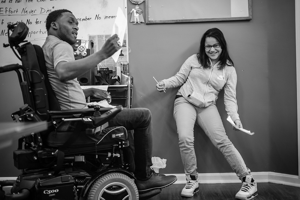 BALTIMORE, MD -- 3/2/16 -- Van jokes with Malaysia Rodriguez during a group exercise.<br /> Van Brooks runs the Safe Alternative Center, which he started to give middle school kids in West Baltimore a safe place to learn and play. <br /> <br /> Brooks was a Division 1 prospect when he played football in high school, but was paralyzed in a freak accident after making a tackle in his junior year. He regained the use of his arms, even walking again with much assistance, and graduated on time from high school. He later earned a degree in marketing from Towson University. Though still confined to a wheelchair, he is self-sufficient and runs the center.&hellip;by Andr&eacute; Chung #_AC22375