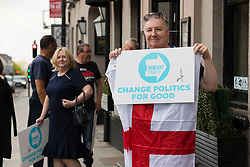 © Licensed to London News Pictures. 16/05/2019. Brentwood, Essex, UK.  Brexit Party supporters leave after listening to Nigel Farage speaking at The Brexit Party campaign event held at the Sugar Hut in Brentwood, Essex. Photo credit: Vickie Flores/LNP