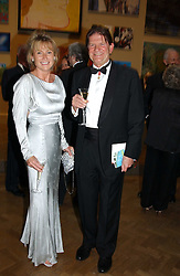 MRS PAUL MYNERS and JOHN MADJESKI at the Royal Academy dinner before the official opening of the Summer Exhibition held at the Royal Academy of Art, Burlington House, Piccadilly, London W1 on 1st June 2005.<br />
