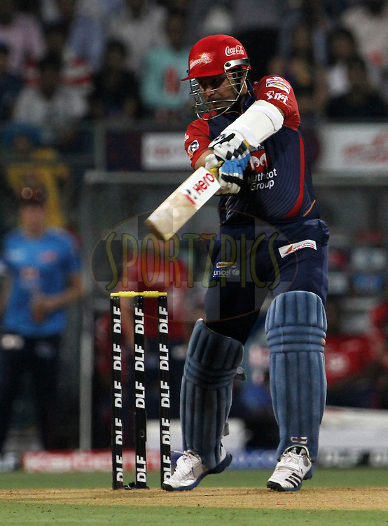 Delhi Daredevils captain Virender Sehwag plays a shot during match 19 of the Indian Premier League ( IPL) 2012  between The Mumbai Indians and the Delhi Daredevils held at the Wankhede Stadium in Mumbai on the 16th April 2012..Photo by Vipin Pawar/IPL/SPORTZPICS