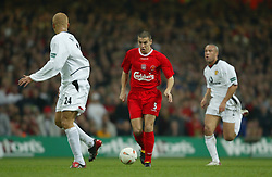 CARDIFF, WALES - Sunday, March 2, 2003: Liverpool's Milan Baros takes on the Manchester United defence during the Football League Cup Final at the Millennium Stadium. (Pic by David Rawcliffe/Propaganda)