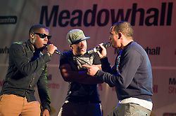 """Up and coming Boy band """"Encore"""" featuring singers Mark and Cairo and rapper Pierre perform at Meadowhalls Christmas lights switch on concert in Sheffield on Thursday evening 3 November 2011. Image © Paul David Drabble"""