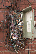 a very messy telephone line wire box outside