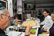 Family around the table for the traditional passover dinner, Handmade Matzah Shmura