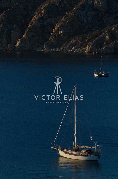 Sailboat against sunrise. Los Cabos, BCS, Mexico