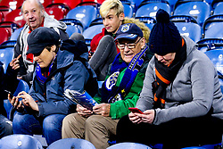 A Huddersfield Town fan reads a match day programme as younger supporters look at their phones - Mandatory by-line: Robbie Stephenson/JMP - 05/11/2018 - FOOTBALL - John Smith's Stadium - Huddersfield, England - Huddersfield Town v Fulham - Premier League
