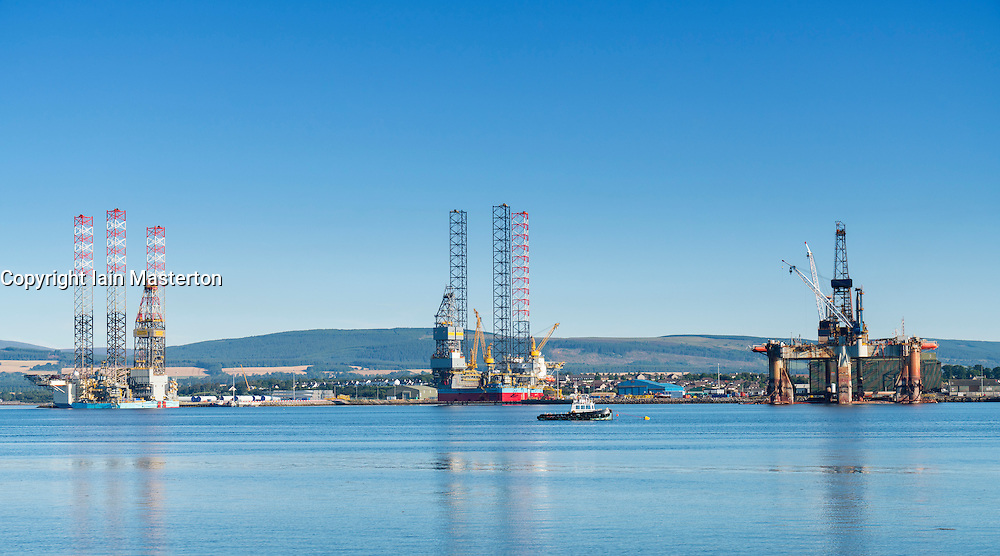 Oil rigs/ drilling platforms moored in Cromarty Firth at Invergordan, in Ross and Cromarty, Highland, Scotland, United Kingdom