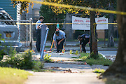 Rochester police work at the scene of a shooting on Hudson Avenue in Rochester, New York on Thursday, September 4, 2014. A Rochester Police Officer was shot and killed Wednesday night, Rochester's first officer killed in the line of duty since 1959. Officer Daryl Pierson, 32, was shot and killed. In May 2015, Thomas Johnson III was convicted of aggravated murder of a police officer.