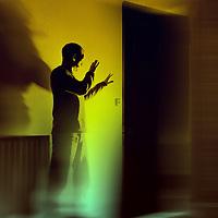 Man with Light behind door