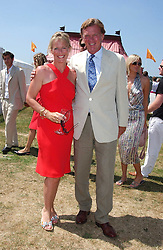 BROOK and SALLY JOHNSON she was Sally Faber at the Veuve Clicquot sponsored Gold Cup Final or the British Open Polo Championship held at Cowdray Park, West Sussex on 17th July 2005.<br /><br />NON EXCLUSIVE - WORLD RIGHTS