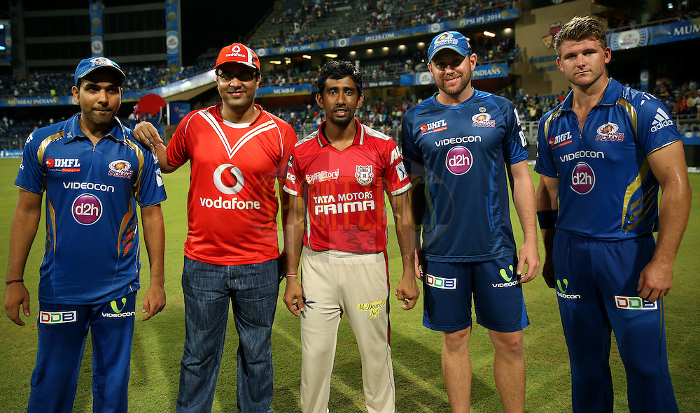 Rohit Sharma captain of of the Mumbai Indians, Vodafone Winner,Wriddhiman Saha of the Kings X1 Punjab, Ben Dunk of the Mumbai Indians and Corey Anderson of the Mumbai Indians pose for the pix during the presentation of the  match 22 of the Pepsi Indian Premier League Season 2014 between the Mumbai Indians and the Kings XI Punjab held at the Wankhede Cricket Stadium, Mumbai, India on the 3rd May  2014<br /> <br /> Photo by Sandeep Shetty / IPL / SPORTZPICS<br /> <br /> <br /> <br /> Image use subject to terms and conditions which can be found here:  http://sportzpics.photoshelter.com/gallery/Pepsi-IPL-Image-terms-and-conditions/G00004VW1IVJ.gB0/C0000TScjhBM6ikg