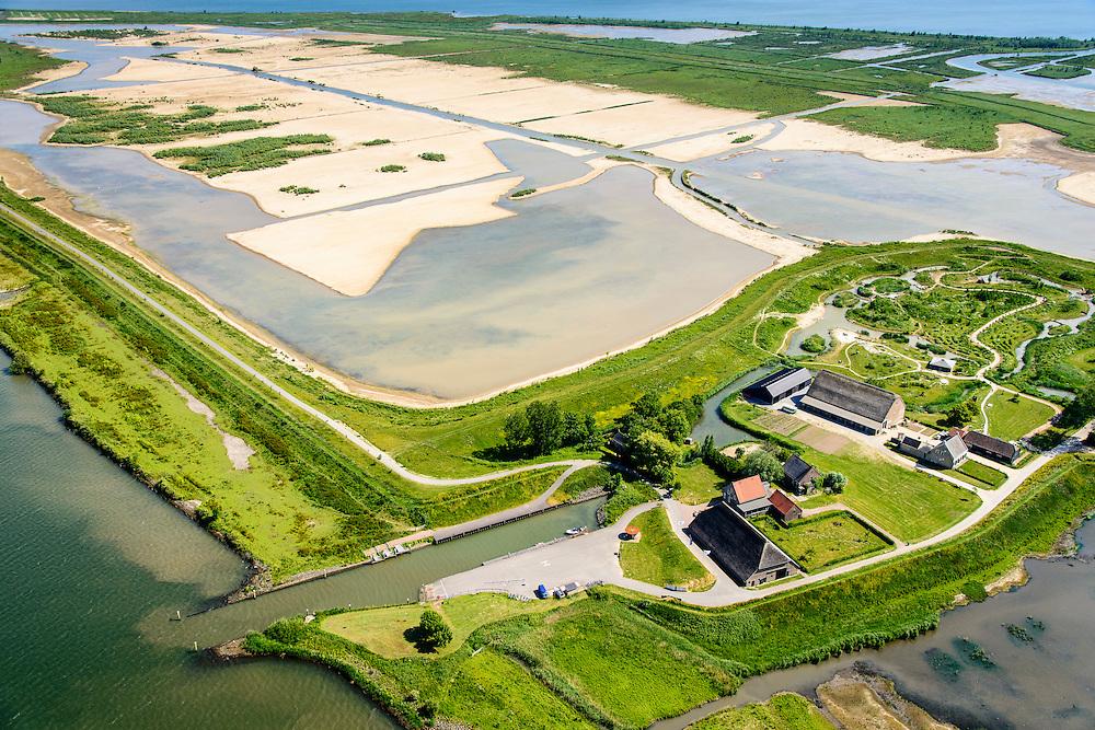 """Nederland, Zuid-Holland, Tiengemeten 10-06-2015; middendeel van het eiland Tiengemeten ter hoogte van de haven en met moeras in wording. <br /> Oorspronkelijk gebruikt voor de akkerbouw maar inmiddels 'teruggegeven aan de natuur', de dijken zijn deels doorgestoken, de laatste boer is in 2006 vertrokken. De 'nieuwe natuur' vormt onderdeel van de Ecologische Hoofdstructuur. <br /> The island Tiengemeten in the Haringvliet, was originally used for agriculture but has now """"been given back to nature"""". Large parts have been flooded and the isle is part of the National Ecological Network. The last farmer left in 2006. Current use, among other, care farms and camping.<br /> luchtfoto (toeslag op standard tarieven);<br /> aerial photo (additional fee required);<br /> copyright foto/photo Siebe Swart"""