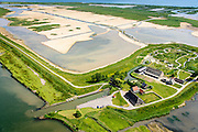 Nederland, Zuid-Holland, Tiengemeten 10-06-2015; middendeel van het eiland Tiengemeten ter hoogte van de haven en met moeras in wording. <br /> Oorspronkelijk gebruikt voor de akkerbouw maar inmiddels 'teruggegeven aan de natuur', de dijken zijn deels doorgestoken, de laatste boer is in 2006 vertrokken. De 'nieuwe natuur' vormt onderdeel van de Ecologische Hoofdstructuur. <br /> The island Tiengemeten in the Haringvliet, was originally used for agriculture but has now &quot;been given back to nature&quot;. Large parts have been flooded and the isle is part of the National Ecological Network. The last farmer left in 2006. Current use, among other, care farms and camping.<br /> luchtfoto (toeslag op standard tarieven);<br /> aerial photo (additional fee required);<br /> copyright foto/photo Siebe Swart