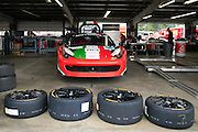 The #784 car, driven by Roberto Cava, awaits a new set of tires in the garage at the Ferrari Challenge North America in Watkins Glen, New York, USA, on Saturday, September 20, 2014. Photographer: Mike Bradley/Bloomberg