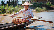 Woman on boat in Inle Lake (Myanmar)