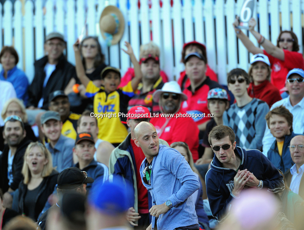 A spectator catches a six. Fill The Basin for Christchurch fundraising cricket match - Canterbury Invitational XI v Wellington Legends XI  at Hawkins Basin Reserve, Wellington, New Zealand on Sunday, 13 March 2011. Photo: Dave Lintott / lintottphoto.co.nz