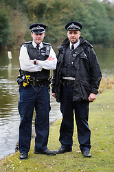 © Licensed to London News Pictures. 22/02/2013 London, UK. PC's Ryan Perry, 38 (right) and Marc Cash, 26 (left) who rescued a woman from a  car submerged in a lake in Totteridge, NW London. The Met Police constables swam out into the freezing water to rescue the unconscious driver, smashing the car windows with a hammer..Photo credit : Simon Jacobs/LNP