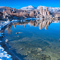 Snow in the mountains and salt foam along the very still Mono Lake, with nice reflections of tufas. Lee Vining, California
