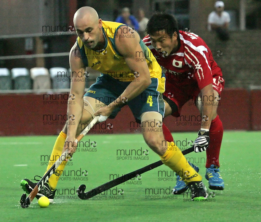 (Canberra, Australia---29 March 2012) Glenn Turner of the Australia Kookaburras keeps the ball away from a Japanese defender in the first of a three match test series held in Canberra. Australia won the game 3-1. Photograph 2012 copyright Sean Burges / Mundo Sport Images and distributed for free media use by Hockey Australia. For enquiries further contact Sean Burges 0404 536 513 / seanburges@yahoo.com.