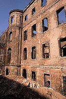 January 1990, Dresden, East Germany --- Forty-five years after the end of World War II, war damage is still apparent in Dresden. The openings in this brick wall once contained arched windows. East Germany. --- Image by © Owen Franken/CORBIS